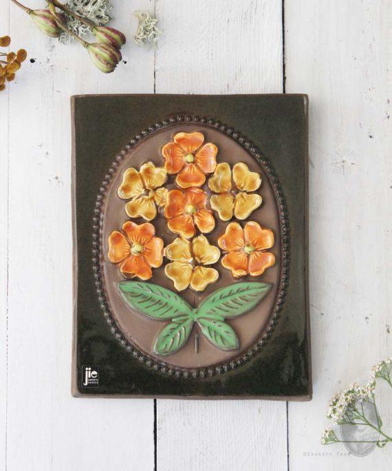 wandtegel oranje gele bloemen
